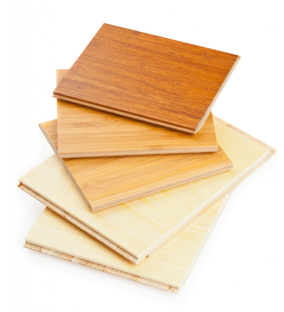 Stack of bamboo laminate flooring samples on white background